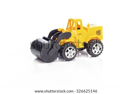 Heavy Construction Machinery Toy, Yellow steam roller machine on white background.