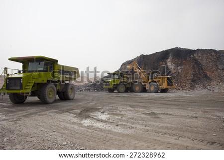 Heavy Dump truck working at mining site,China - stock photo