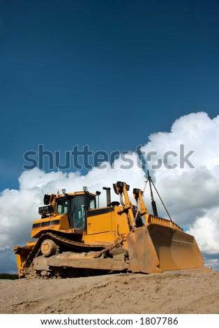Heavy duty bulldozer at work - stock photo