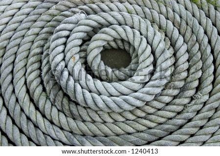 Heavy duty coiled rope. - stock photo