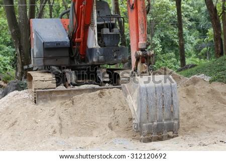 Heavy duty construction equipment parked - stock photo
