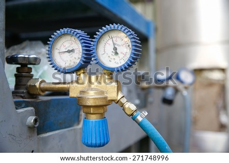 Heavy-duty dual industrial manometer, measuring pipeline/hose pressure, preventing over pressurization in machinery.   - stock photo