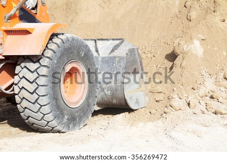 heavy earth moving excavator loader at construction works - stock photo