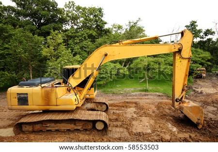 Heavy excavator construction truck - stock photo