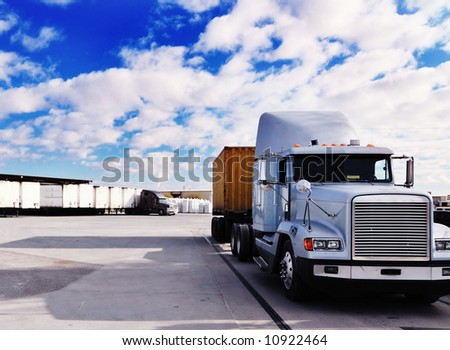 Heavy goods truck leaving loading bay - this image has been cross processed - stock photo