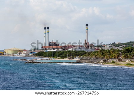 Heavy Industrial fuel plant on the coast of Curacao - stock photo