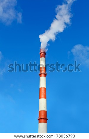 Heavy industry makes problems with a global warming. Smoke and steam cause environmental pollution destroying  the nature. - stock photo