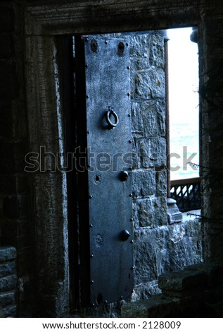 heavy iron door at entrance to the garden at hammond castle in gloucester massachusetts