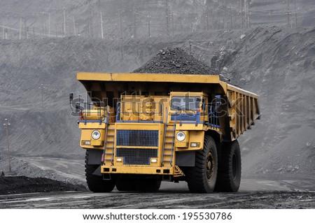 heavy-load car, multiton dump truck, coal transportation, breed, ore, pit, section, mine, new technologies,  - stock photo