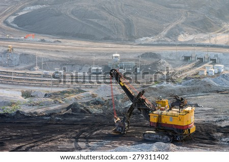 Heavy machinery Digging for coal Mae Moh mine in Lampang - stock photo