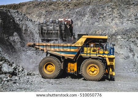 Heavy machinery, quarry, iron ore, ore extraction.