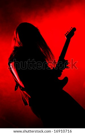 Heavy metal guitarist live on stage - stock photo