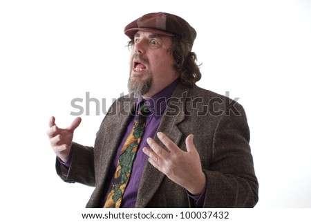 Heavy middle-aged man with goatee, cap and tweed jacket speaks and gestures with palms up. Horizontal, isolated on white, copy space. - stock photo