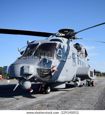Heavy navy helicopter on the ground front view - stock photo