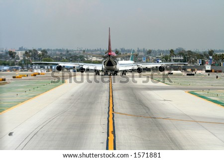 heavy plane on taxiway, Los Angeles Airport - stock photo
