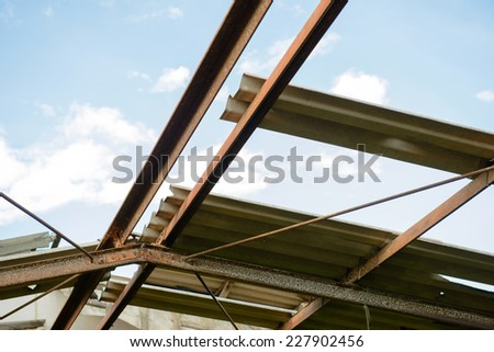 Heavy rain and storm damaged house roof in Thailand - stock photo