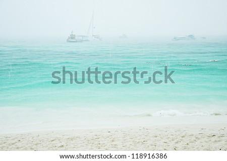 Heavy rain on the beach - stock photo