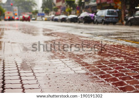 Heavy rain on the road in the city (Kuala Lumpur) - selective focus - stock photo