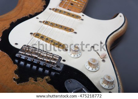 Heavy Relic Vintage electric guitar on grey background