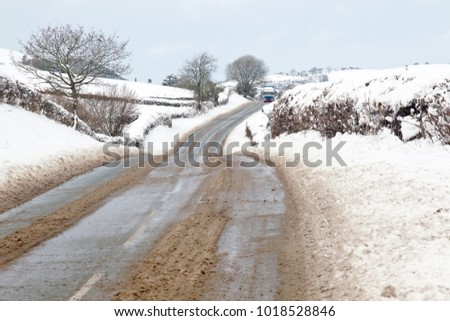 Heavy snowfall around rural areas of the UK start to melt after gritters and snow ploughs have treated the highways