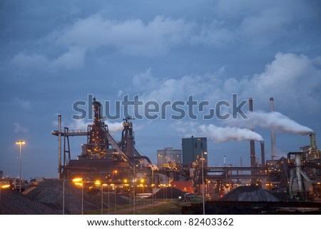 Heavy steel industry at steel factory at night
