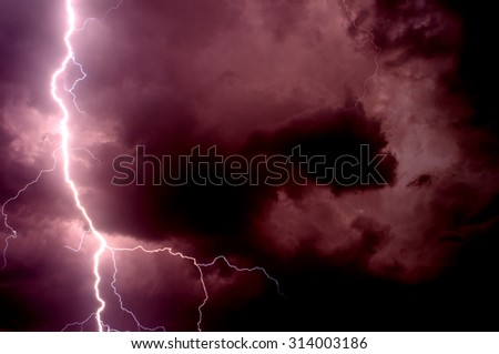 Heavy storm bringing thunder, lightnings and rain in summer. - stock photo