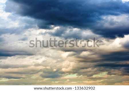 Heavy storm clouds bringing the cold winter rain - stock photo