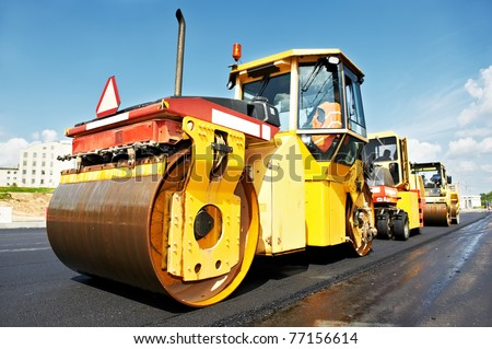Heavy tandem Vibration roller compactor at asphalt pavement works for road repairing - stock photo