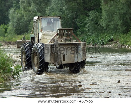 Heavy tractor crossing river
