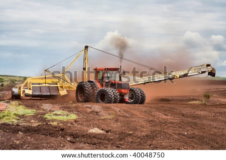 Heavy tractors and machinery collecting bog in Ireland. - stock photo