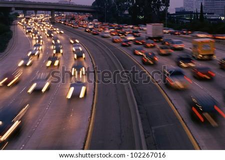 Heavy traffic on freeway at twilight - stock photo