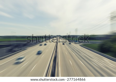 heavy traffic on highway ,fast cars traveling on the highway ,abstract speed transportation  background - stock photo