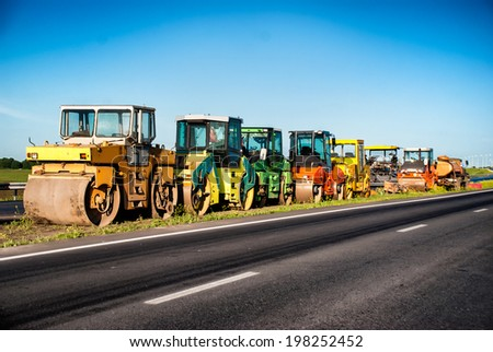 Heavy Vibration roller at asphalt pavement works. Concept photo of road works. - stock photo