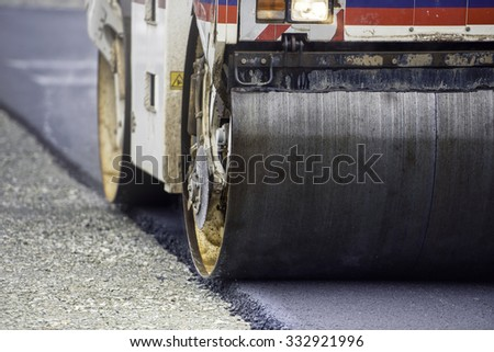 Heavy Vibration roller compactor at asphalt pavement works for road and highway construction - stock photo