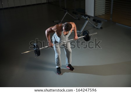 Heavy Weights. Man Doing Heavy Weight Exercise For Back - stock photo