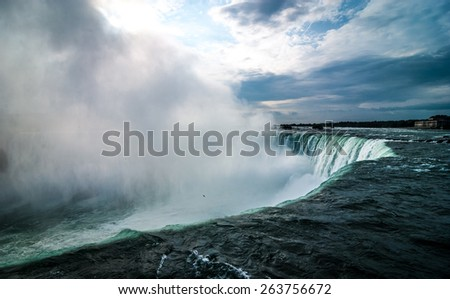 heavy wet mist rises out of the mighty Niagara river Falls - stock photo