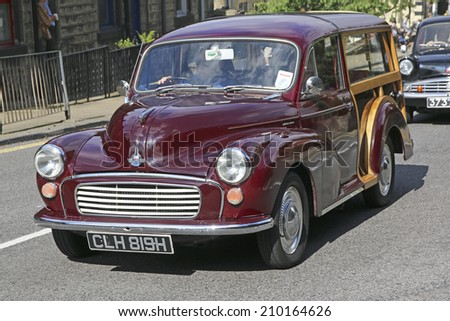 HEBDEN BRIDGE, WEST YORKSHIRE - AUGUST 2, 2014: Car driving through Hebden Bridge  to take part in Vintage Car Weekend, a popular family event which attracts hundreds of vintage and classic cars.