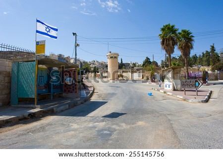 HEBRON, ISRAEL - 10 OCT,  2014: Deserted street with watchtower in the jewish quarter near the center of Hebron - stock photo
