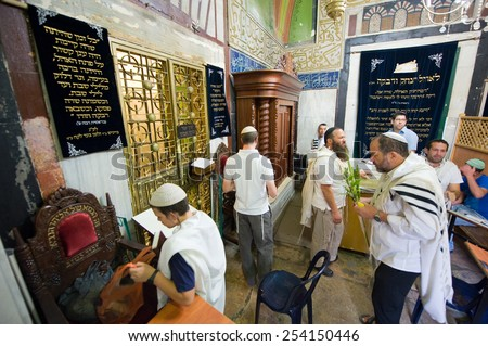 HEBRON, ISRAEL, 10 OCT, 2014: Jews are celebrating sukkot in front of the The tomb of Sarah, wife of patriarch Abraham. The tombs of the patriarchs are situated in the Cave of Machpelah in Hebron - stock photo