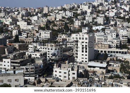 HEBRON, PALESTINA - DECEMBER 7, 2013, Hebron, Palestina. Hebron is the hottest point of Jewish - Muslim conflict. Jewish quarter is strictly guarded. - stock photo