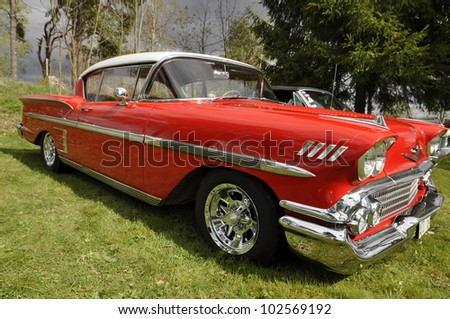 HEBY, SWEDEN - MAY 12: Exhibit of old American classic cars. Chevrolet Impala 58th and organizes are Restless cruisers and official name Restless cruisers in Heby, Sweden on May 12, 2012 - stock photo