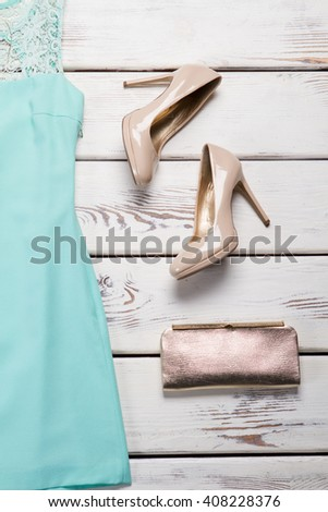 Heel shoes and clutch bag. Purse with footwear on showcase. Beige shoes and silver handbag. New arrivals in fashion boutique. - stock photo
