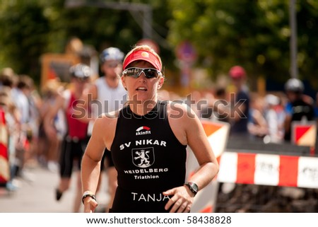 HEIDELBERG - AUGUST 1.  Female runner at Heidelberg Triathlon competition. August the 1st, 2010 in Heidelberg, Germany.
