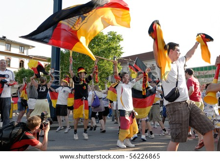 HEIDELBERG, GERMANY - JUNE 27 : German soccer fans celebrate Germany beat England at the world cup at the Adenauer Platz on June 27, 2010 in Heidelberg, Germany - stock photo