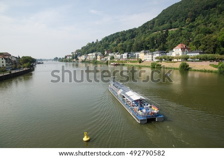 HEIDELBERG, GERMANY - SEPTEMBER 15:  Tourists going by the sightseeing boat Neckarsonne at the river Neckar in the city Heidelberg in Germany on September 15, 2016.