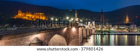 Heidelberg, Panorama View the Old Bridge over Neckar river with Heidelberg Castle on the hill, Altstadt, The Church of the Jesuits, Holy Spirit, St. Peter's Church illuminated at night summer, Germany