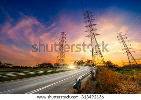 Height voltage electricity pylon system on sunrise background - stock photo