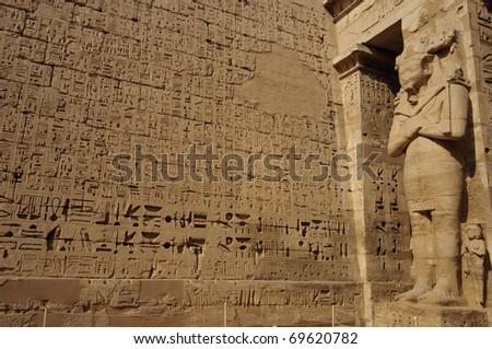 Heiroglyphs and relief of Medinat Habu. Luxor, Egypt - stock photo
