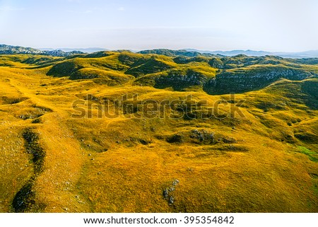 Helicopter aerial photo at sunrise of the Montenegro continental part and nature. - stock photo
