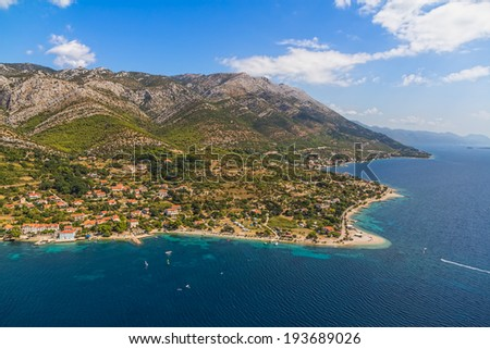 Helicopter aerial shoot of sandy beach Zrnovo near Orebic on Peljesac peninsula, Croatia. World known surfers destination.